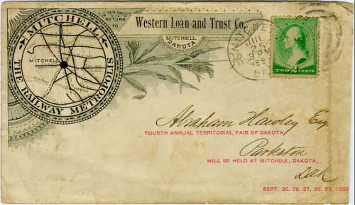"Mitchell, Dak. Jul 25 300PM 1888 postmark in black with duplex killer on 2c green banknote stamp. Western Loan and Trust Co, Mitchell Dakota corner card. Illustrated ad showing Mitchell as ""The Railway Metropolis"" (numerous other eastern South Dakota towns also proclaimed themselves as the railway hub). In addition, this cover features a discrete advertisement within the address area for the Fourth Annual Territorial Fair of Dakota."