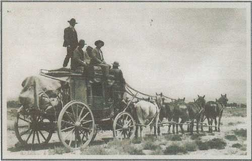 A Stage Coach Going Down The Trail